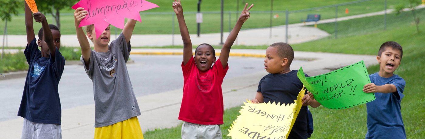Monroe Elementary School Students Holding Signs
